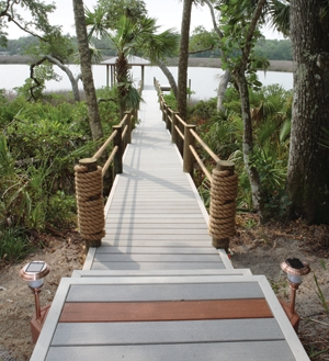 Moisture-resistant composite decking boards can be used on the ground, in the ground and in the water.