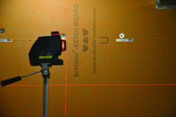 A Bosch laser level was used to guide the tile and ledger layout.