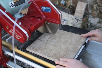 A quality wet saw, such as the MK Diamond model shown, is a high-productive tool for major tile installations.