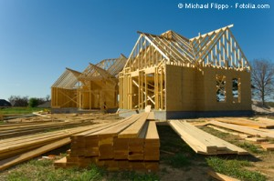 By using roughly half of the currently required mortgage down payment to purchase a developed lot in a subdivision, the homeowner still has the remaining half to purchase enough materials to