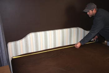 First step to installing the headboard is to determine its midpoint.