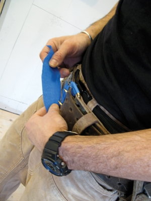 One of my biggest fears installing cabinets is hitting them against my belt buckle and damaging a door. It's never happened to me, but I don't want there to be a first time. As a layer of protection I wrap the buckle in blue tape before going to work.