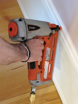 I use a pneumatic nailer to fasten new trim to existing plaster. To make sure I get a snug connection to the wood lath, I sometimes nail in a V pattern.