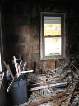 Plaster and lath pile up fast in a knotty web of major mess. We usually bag up the debris and toss it out a window rather than dragging it through a finished home. Protecting finished floors from this chaos is critical.