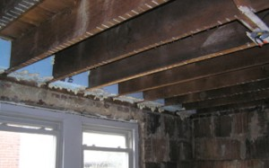While the walls are open, the time is right for sealing the building envelope in areas you might not think of, such as along the ceiling joists.