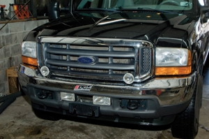 Shown is the front of our Super duty before installing the new winch. We found that the fog light locations were OK, but the driving lights would have to move.