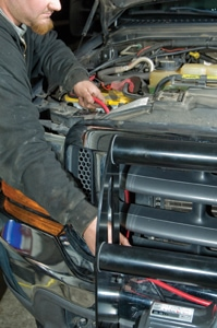 We threaded the electrical cables up through the grille to the passenger-side battery.