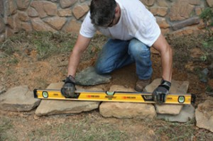 I use my 4-foot Johnson Level to periodically check that the border remains relatively flat and level.