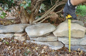 Although the border required more stones at one end than the other, the height never exceeded more than 14