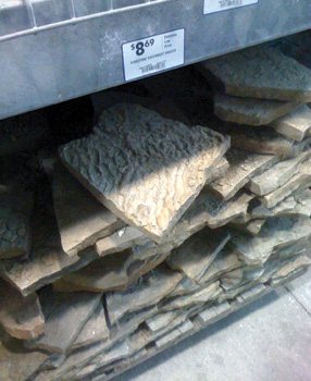 There wasn't enough leftover stone to complete the border, so I went to the home center to check into the readily available supply. After seeing the price per stone, I left empty-handed.
