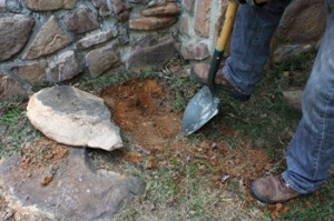 To keep the top of the row relatively level, I had to dig a trench for some of the stones to sit slightly below grade. Recessing the stones into the ground also adds stability to the garden border.