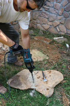 I cut some of the stones to a particular size and shape with a chipping hammer. Begin with a narrow chisel, cutting a shallow score line across the stone.