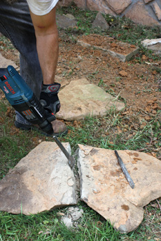 Follow the score line with a broader chisel to open the crack and complete the cut.