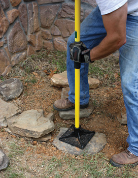 It helps to tamp the stone into the soil and add backfill to help hold them stationary.
