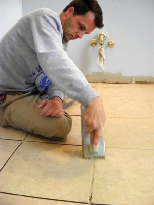 Apply the grout in 3' or 4' foot square sections at a time, pushing it into the grout lines with a rubber float.