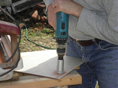 a carbide tip bit is the best way to drill small holes in tile and
