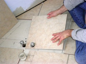 For the bathtub drain, I simply inscribe an outline of the drain hole on the tile and then use a wet saw with a diamond blade to cut from the outer edge of the tile up to that line. I then snap those pieces off with my tile snips.