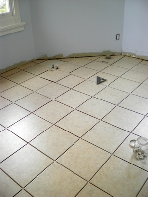 After all of the tiles have been dry-fit into place, stand back and look down the empty grout lines to make sure they look straight and even.