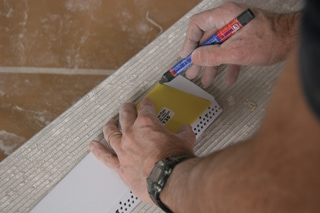 A miter marking tool, which is included in each box of EZ-Tray, is used to mark the line that will be cut with tin snips.