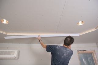 The bead is then positioned on the ceiling. Note that the first piece  attached in