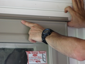 Set the drip cap with an even reveal above the door.