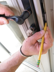 Layout the latch and bolt on the strike-side rail. Make an X between the layout lines so you know what the lines mean.