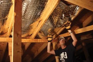 The panels friction-fit between the roof rafters.