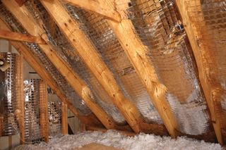 A radiant barrier can reflect up to 96 percent of the sun's energy, reducing the attic temperature by as much as 30 degrees.