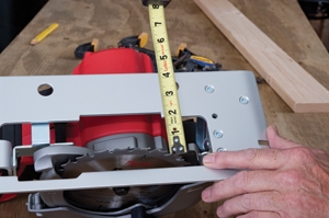 If cutting plywood with a guide board, measure the saw to the inside of carbide tooth.