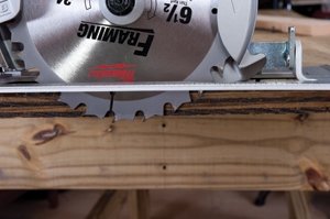 Set the saw blade one tooth deeper than the thickness of the material being cut.