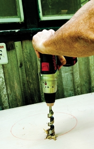 If adding a lift-out basin, first mark your circle cut and then drill a starter hole for the jigsaw.