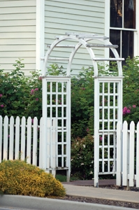 Gate openings can be handled in a variety of ways. A cleaner approach here could have incorporated the fence posts on each side of the arched trellis into the trellis design.