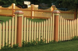 A bold, two-tone color scheme, large posts and curved picket arrangements offers several ideas to out-of the box picket fence designers.