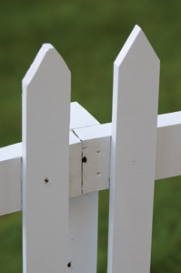 In the hidden-post design, the fence rails are mounted on the outside of the post and are joined together on the post.