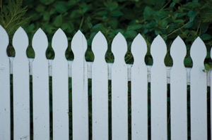 A lower top rail and larger gaps would have helped the look of this fence. In general, a picket fence should have gaps between pickets that equal the width of the pickets.