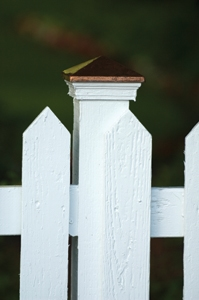 Mixing two different design concepts creates problems. Hide the post or bring out front in the design.