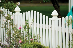 This vinyl fence creates interesting lines with the post caps and varying length of pickets.