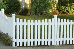 Capped fence posts and a gentle curve cut in the top of the pickets give this fence its character.