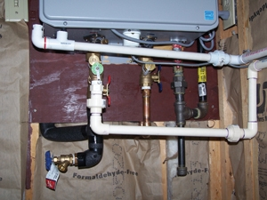 Both the tankless unit and the air-intake require condensation drains.
