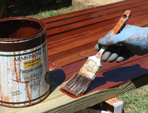 Depending on the condition of your lumber, you may be able to save time and labor by staining the wood prior to assembly, as in the case of the deck handrails shown.