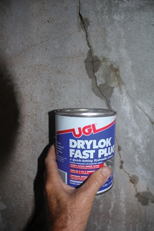 cracks and holes can be patched using a fast setting hydraulic cement