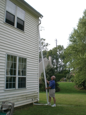 Water accumulation against the foundation wall can seep into the basement. Clogged gutters and downspouts are often the problem. Products like The Spout-Off make it easy to clean downspouts from the ground.