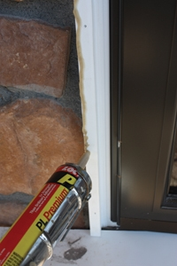 Attach the pilasters with a combination of poly adhesive, finish nails and concrete screws (if fastening into masonry).