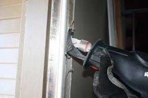 Cut loose any screws along the jamb with a recip saw.