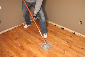 After the poly dries, scuff-sand the floor between coats to promote better adhesion of the next coat of varnish.