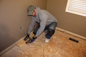 Start the layout of the first row by snapping a chalk line along the longest, straightest wall of the room to use as a guide.