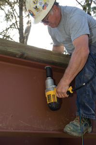 Mike used an electric impact driver to torque the nuts onto the stringer bolts.