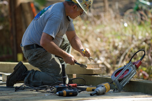 The curbs along each side of the bridge required a splice that Mike cut using a circular saw and a chisel.