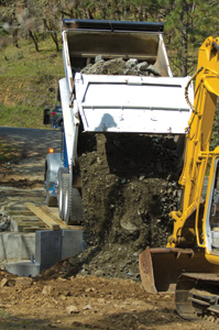 The first vehicle on the bridge was a fully-loaded dump truck. Truck driver Jeremy Williams didn't look a bit concerned as eh back3ed a load of riprap over the bridge to back-fill the cross-stream abutment.