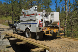 Soon after completing the bridge, Jon Ford started a house construction project so construction traffic like this power company truck put the new bridge to good use.